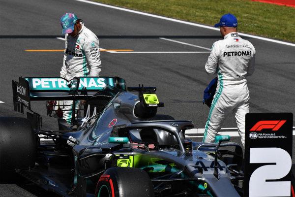 Lewis Hamilton, Mercedes AMG F1, and pole man Valtteri Bottas, Mercedes AMG F1, on the grid after Qualifying