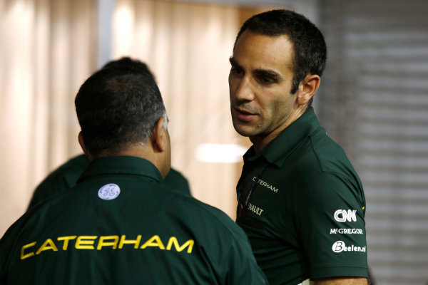 Marina Bay Circuit, Singapore. Friday 20th September 2013. Tony Fernandes, Co-Chairman, Caterham Group with Cyril Abiteboul, Team Principal, Caterham F1. World Copyright: Charles Coates/LAT Photographic. ref: Digital Image _N7T2902