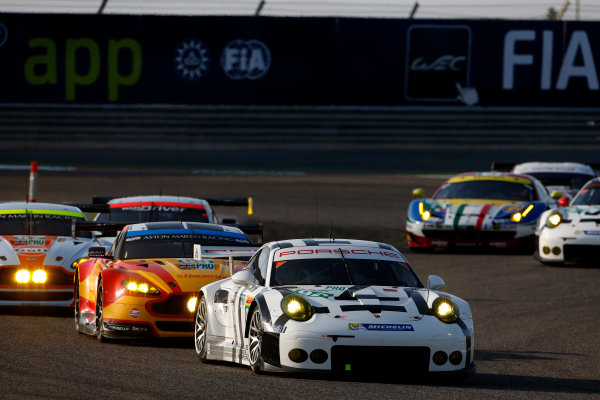 2015 FIA World Endurance Championship Bahrain 6-Hours Bahrain International Circuit, Bahrain Saturday 21 November 2015. Patrick Pilet, Fr?d?ric Makowiecki (#92 GTE PRO Porsche AG Team Manthey Porsche 911 RSR) leads Alex MacDowall, Fernando Rees, Richie Stanaway (#99 GTE PRO Aston Martin Racing Aston Martin Vantage V8), Darren Turner, Jonny Adam (#97 GTE PRO Aston Martin Racing Aston Martin Vantage V8) and Christoffer Nygaard, Marco S?rensen, Nicki Thiim (#95 GTE PRO Aston Martin Racing Aston Martin Vantage V8). World Copyright: Alastair Staley/LAT Photographic ref: Digital Image _79P0207