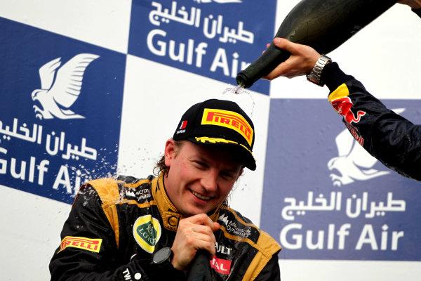 Bahrain International Circuit, Sakhir, Bahrain22nd April 2012Kimi Raikkonen, Lotus GP, 2nd position, gets a soaking.World Copyright: Andy Hone/LAT Photographicref: Digital Image HONY8711