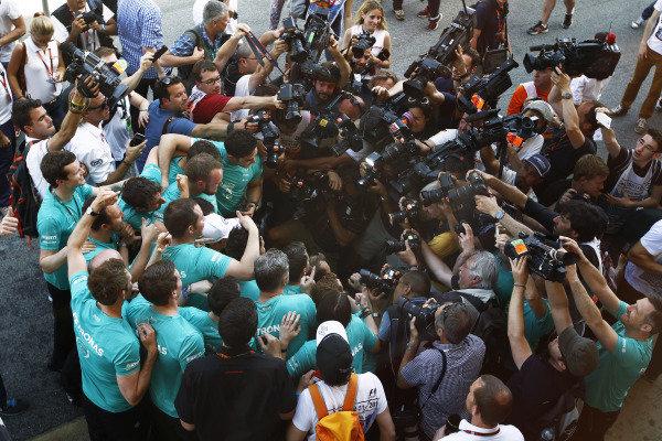 Circuit de Catalunya, Barcelona, Spain. Sunday 10 May 2015. Nico Rosberg, Mercedes AMG, 1st Position, celebrates victory with his team. World Copyright: Sam Bloxham/LAT Photographic. ref: Digital Image _G7C5024