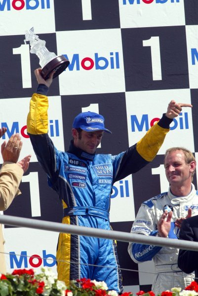 Jarno Trulli (ITA) Renault celebrates his third position on the podium.Formula One World Championship, Rd12, German Grand Prix, Race Day, Hockenheim, Germany, 3 August 2003.DIGITAL IMAGE