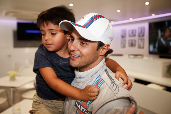 Autodromo Nazionale di Monza, Monza, Italy. Sunday 7 September 2014. Felipe Massa, Williams F1, 3rd Position, celebrates with his son. World Copyright: Glenn Dunbar/LAT Photographic. ref: Digital Image _W2Q0813