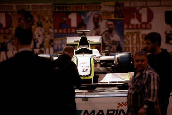 NEC, Birmingham. 14th January 2010.Visitors admire Jenson Button's F1 World Championship winning Brawn GP BGP001 at the F1 Racing display.World Copyright: Drew Gibson/LAT Photographicref: Digital Image _Y8P4605