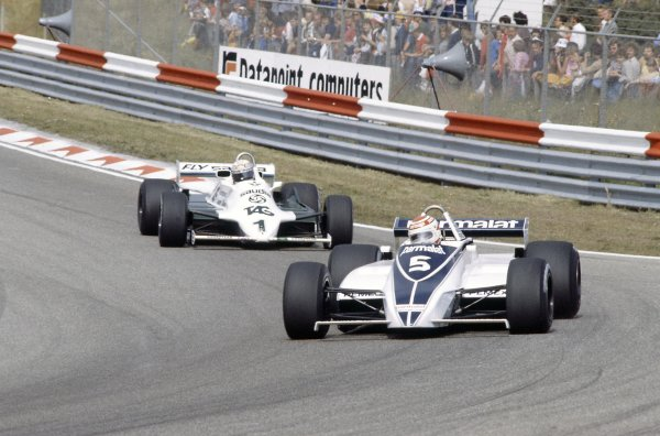 1981 Dutch Grand PrixZandvoort, Holland. 28-30 August 1981.Nelson Piquet (Brabham BT49C-Ford Cosworth), 2nd position, leads Alan Jones (Williams FW07C-Ford Cosworth), 3rd position. Ref - 81HOL04.World Copyright - LAT Photographic