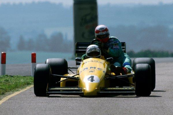 Eric Bernard (FRA) Ralt RT22 gives Paul Belmondo (FRA) Lola a lift back to the pits.1988 International Formula 3000 Championship.
