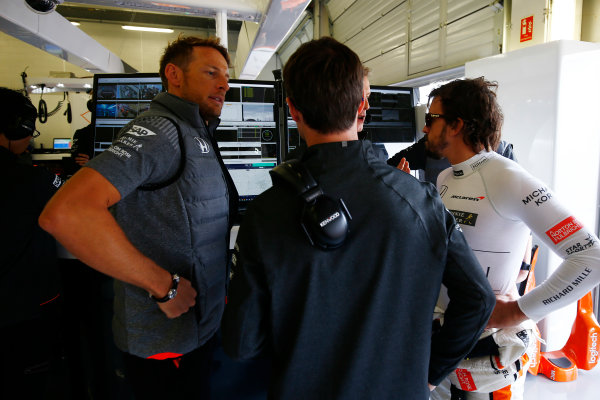 Silverstone, Northamptonshire, UK.  Sunday 16 July 2017. Jenson Button, McLaren, and Fernando Alonso, McLaren, in the garage. World Copyright: Andrew Hone/LAT Images  ref: Digital Image _ONZ6829