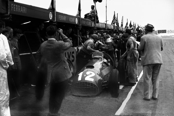 Silverstone, Great Britain. 14 July 1951.Jose Froilan Gonzalez (Ferrari 375), 1st position. Teammate Alberto Ascari looks on as Gonzalez's winning car makes a pit stop. This was Ferrari's first GP victory. Ref-51/37 #31.World Copyright - LAT Photographic.