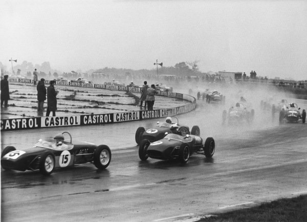 Silverstone, England 1st October 1960.Trevor Taylor (Lotus 18 - Ford/Cosworth), 4th position, leads at the start, Henry Taylor (Cooper T52 - BMC), 1st position and Peter Arundell (Lotus 18 - Ford/Cosworth), 2nd position, action. World Copyright: LAT Photographic.Ref:  B/W Print.
