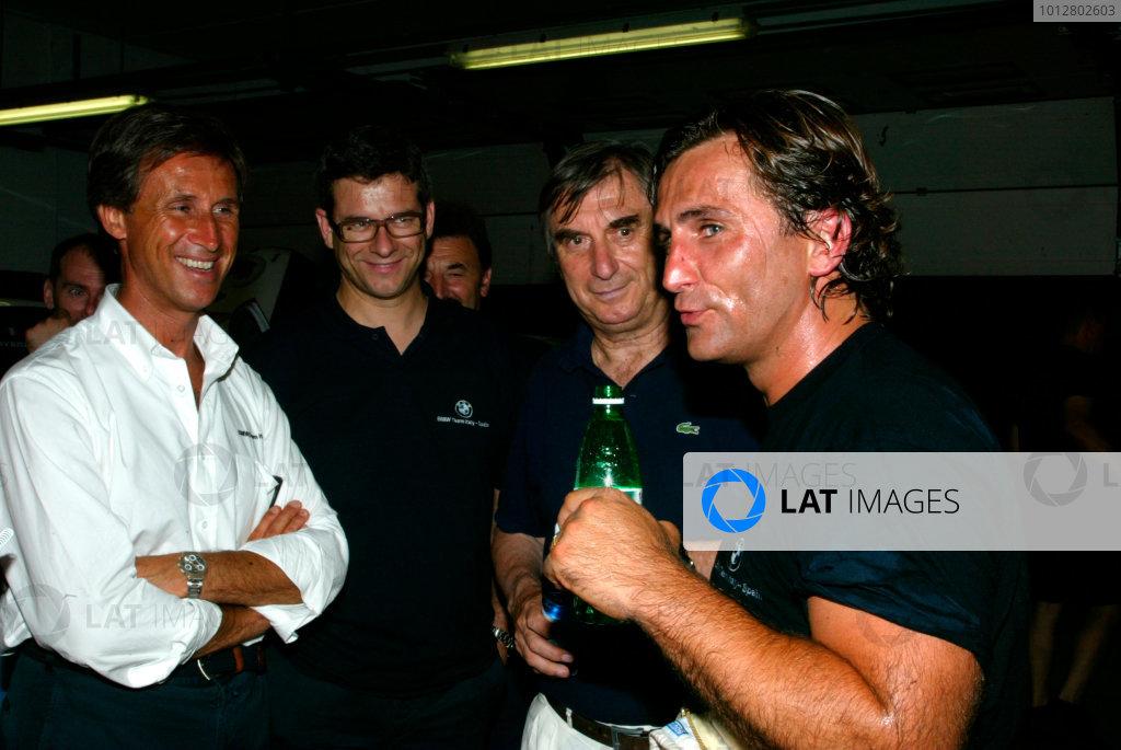 2003 European Touring Car ChampionshipAlex Zanardi BMW ETC Test.Missano, Italy. 15th July 2003.Alex Zanardi experiences the BMW of Team Ravaglia. Here with Roberto Ravaglia and track engineer Olivan Giovanardi.World Copyright: Photo4/LAT Photographic