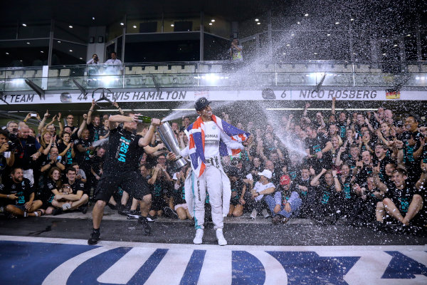 Yas Marina Circuit, Abu Dhabi, United Arab Emirates. Sunday 23 November 2014.  Lewis Hamilton and the Mercedes team celebrate championship victory.  World Copyright: Steve Etherington/LAT Photographic. ref: Digital Image SNE22524
