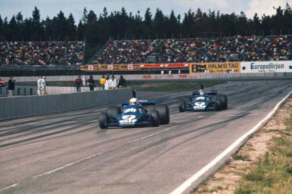 1974 Swedish Grand Prix  Anderstorp, Sweden. 7-9 June 1974.  Jody Scheckter, Tyrrell 007 Ford, 1st position, leads teammate, Patrick Depailler, Tyrrell 007 Ford, 2nd position.  Ref: 74SWE10. World Copyright: LAT Photographic
