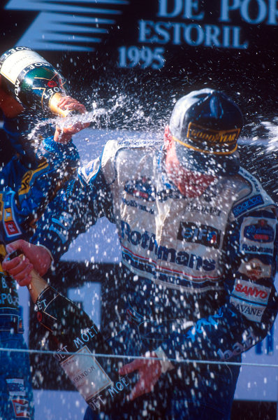 Estoril, Portugal.22-24 September 1995.David Coulthard (Williams Renault) 1st position, his maiden Grand Prix win on the podium. Ref-95 POR 05.World Copyright - LAT Photographic
