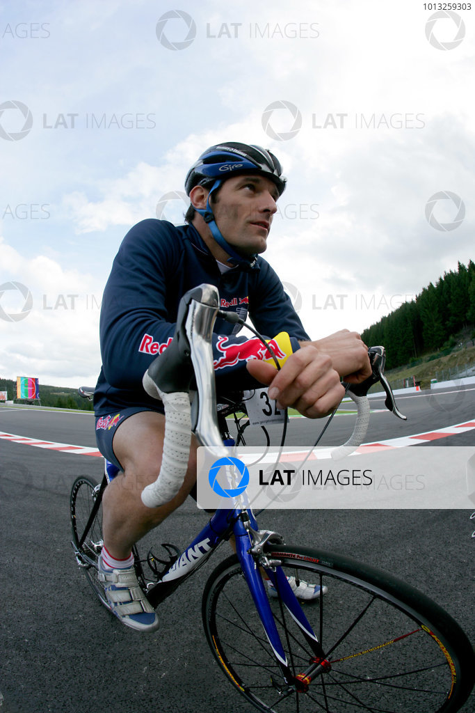 Spa Francorchamps, Spa, Belgium.4th September 2008.Mark Webber, Red Bull Racing RB4 Renault on track on a bicycle. Portrait.World Copyright: Andrew Ferraro/LAT Photographicref: Digital Image VY9E8655