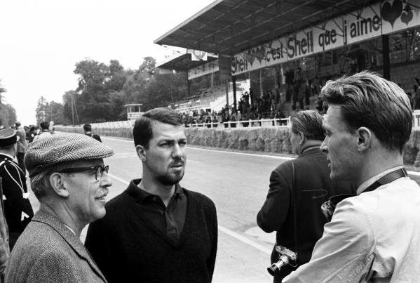Jo Bonnier (SWE) (Facing, centre) talks with his Porsche team mate Dan Gurney (USA) (right) who would take his and PorscheÕs first Grand Prix victory.  With them (left) is Porsche team manager Huschke von Hanstein.