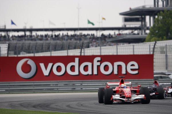 2006 USA Grand Prix - Friday Practice Indianapolis, Indiana, USA. 29th June - 2nd July. Felipe Massa, Ferrari 248F1, leads Scott Speed, Toro Rosso STR01-Cosworth, action. World Copyright: Charles Coates/LAT Photographic ref: Digital Image ZK5Y6060