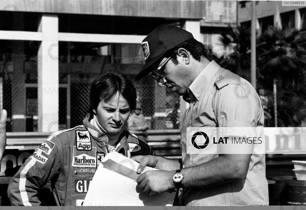 Monte Carlo, Monaco. 27th May 1979.Gilles Villeneuve (Ferrari 312T4) retired, talks with Mauro Forghieri, portrait.World Copyright: LAT PhotographicRef: L79/819-19