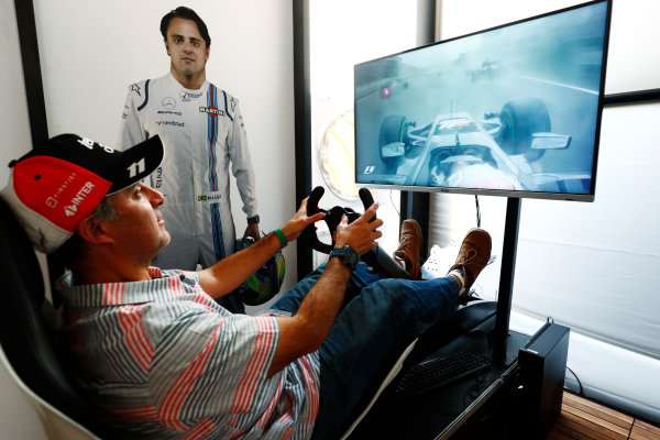 Autodromo Hermanos Rodriguez, Mexico City, Mexico. Sunday 29 October 2017. A fan tries his hand on an F1 driving sim. World Copyright: Sam Bloxham/LAT Images  ref: Digital Image _W6I0596