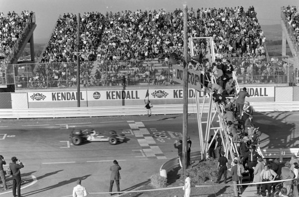 Jochen Rindt, Lotus 49B Ford, takes the chequered flag for victory.