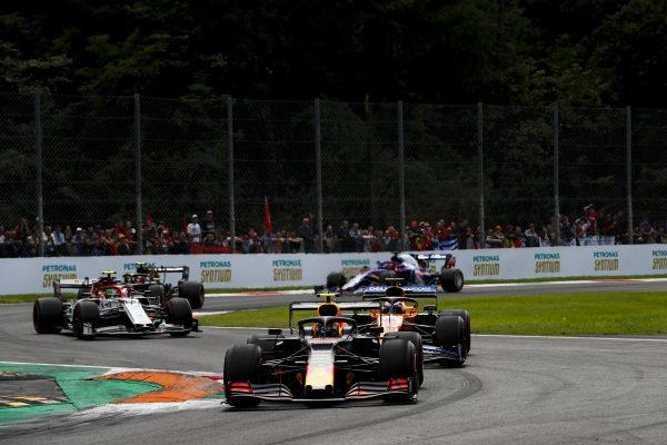 Alexander Albon, Red Bull RB15, leads Carlos Sainz Jr., McLaren MCL34, and Antonio Giovinazzi, Alfa Romeo Racing C38
