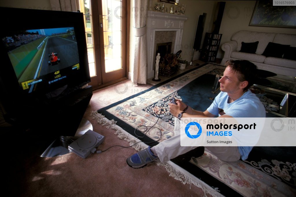 Jenson Button (GBR) relaxes by playing on a Playstation. Jenson Button Lifestyle, England, 1999.