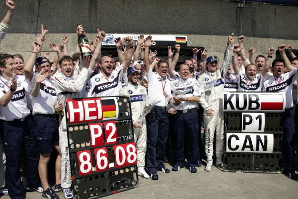 The BMW Sauber team celebrate their 1-2 result in the pit lane.