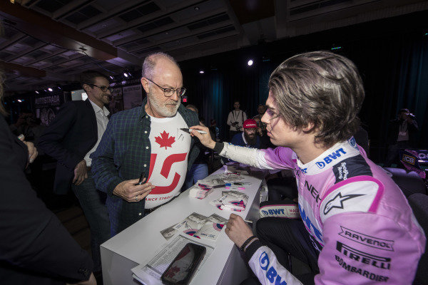 Lance Stroll, SportPesa Racing Point F1 Team signs an autograph for a fan during the SportPesa Racing Point F1 Team Launch in Toronto