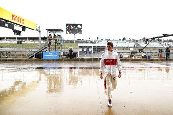 Charles Leclerc, Sauber C37 Ferrari, in the wet pit lane