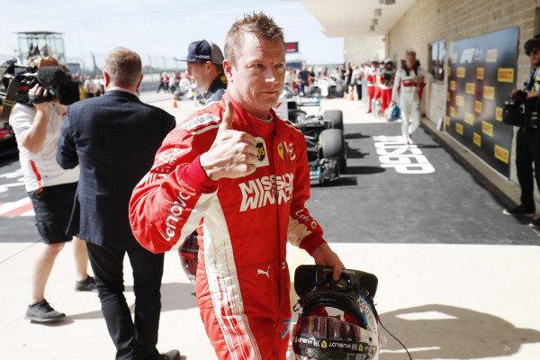 Race winner Kimi Raikkonen, Ferrari, 1st position, gives the thumbs up