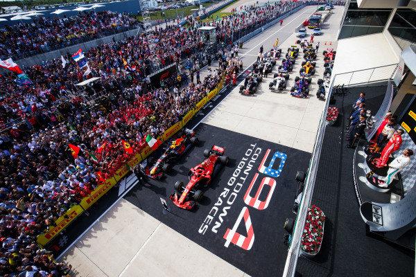 Max Verstappen, Red Bull Racing, 2nd position, Kimi Raikkonen, Ferrari, 1st position, and Lewis Hamilton, Mercedes AMG F1, 3rd position, on the podium