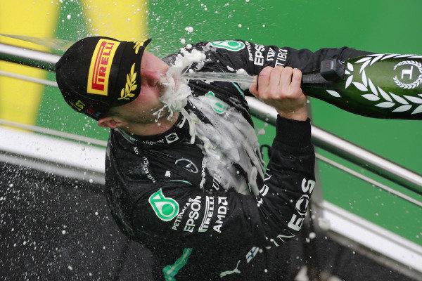 Valtteri Bottas, Mercedes, 1st position, sprays the victory Champagne on the podium