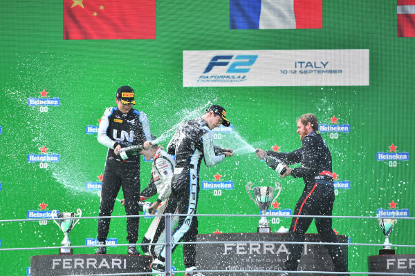 Guanyu Zhou (CHN, Uni-Virtuosi Racing), 2nd position, and Christian Lundgaard (DNK, ART Grand Prix), 3rd position, spray champagne on the podium