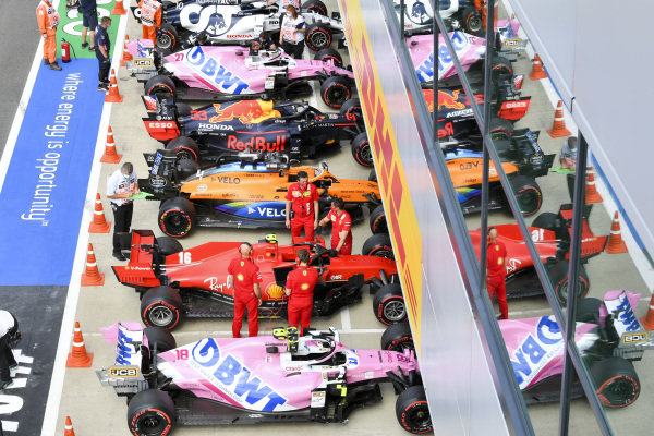 The cars of Lance Stroll, Racing Point RP20, Charles Leclerc, Ferrari SF1000, Lando Norris, McLaren MCL35, Max Verstappen, Red Bull Racing RB16, Nico Hulkenberg, Racing Point RP20, and Pierre Gasly, AlphaTauri AT01, in Parc Ferme