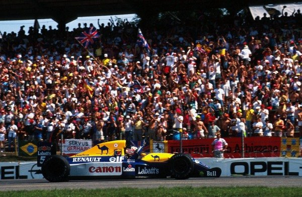 Race winner Nigel Mansell (GBR) Williams FW14B waves to the crowds.  German Grand Prix, Hockenheim, 26 July 1992.