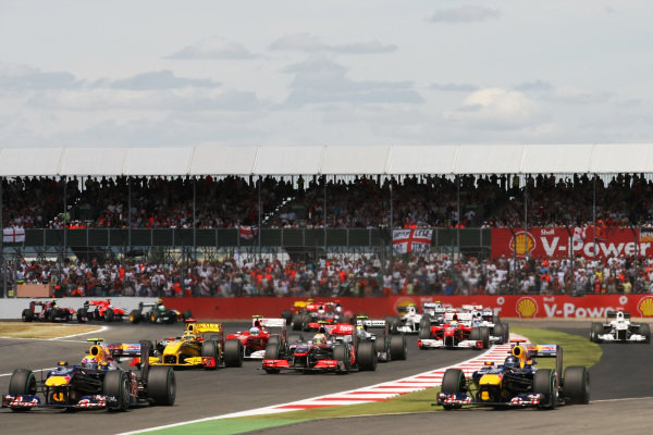 Mark Webber (AUS) Red Bull Racing RB6 leads at the start of the race as team mate Sebastian Vettel (GER) Red Bull Racing RB6 runs wide. Formula One World Championship, Rd 10, British Grand Prix, Race, Silverstone, England, Sunday 11 July 2010.  BEST IMAGE