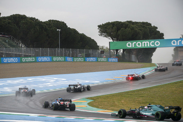 Yuki Tsunoda, AlphaTauri AT02, leads Fernando Alonso, Alpine A521, Esteban Ocon, Alpine A521, and Sebastian Vettel, Aston Martin AMR21
