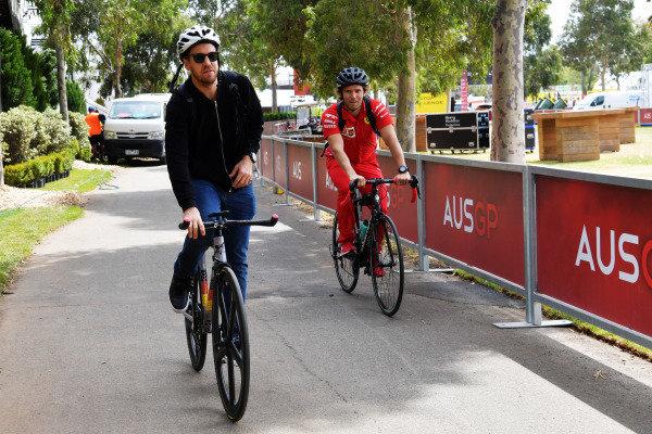 Sebastian Vettel, Ferrari, arrives at the track on a bicycle