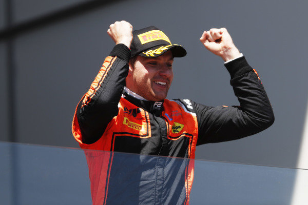 Jordan King (GBR, MP MOTORSPORT), celebrates on the podium after winning the race
