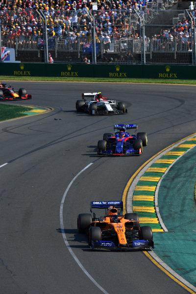 Carlos Sainz Jr., McLaren MCL34, leads Daniil Kvyat, Toro Rosso STR14, and Antonio Giovinazzi, Alfa Romeo Racing C38