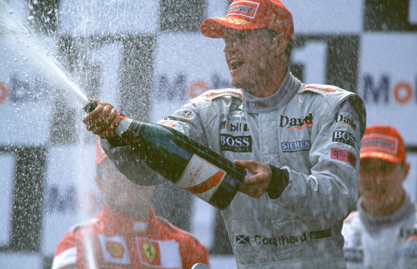 2000 French Grand Prix.Magny-Cours, France. 30/6-2/7 2000.David Coulthard (McLaren Mercedes) celebrates his 1st position on the podium.World Copyright - Steven Tee/LAT PhotographicFormat: 18mb Digital Image
