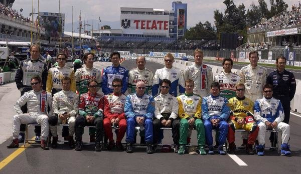 The Champ Car drivers pose for a photograph in the pitlane. Back row (L to R): Gualter Salles (BRA) Dale Coyne Racing, Rodolfo Lavin (MEX) Walker Racing, Mario Dominguez (MEX) Herdez Racing, Luis Diaz (MEX) Walker Racing, Roberto Moreno (BRA) Herdez Racing, Mika Salo (FIN) PK Racing, Ryan Hunter-Reay (USA) American Spirit Team Johansson, Roberto Gonzalez (MEX) Herdez Racing, Geoff Boss (USA) Dale Coyne Racing, Darren Manning (GBR) Walker Racing. Front row (L to R): Jimmy Vasser (USA) American Spirit Team Johansson, Tiago Monteiro (POR) Fittipaldi Dingman Racing, Adrian Fernandez (MEX) Fernandez Racing, Michel Jourdain Jr. (MEX) Team Rahal, Paul Tracy (CDN) Forsythe Racing, Bruno Junqueira (BRA) Newman Haas, Sebastien Bourdais (FRA) Newman Haas, Patrick Carpentier (CDN) Forsythe Racing, Mario Haberfeld (BRA) Conquest Racing, Alex Tagliani (CDN) Rocketsports Racing.