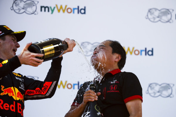 Max Verstappen, Red Bull Racing, 1st position, pours Champagne over Toyoharu Tanabe, F1 Technical Director, Honda