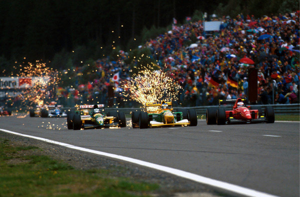 L to R: Sixth place finisher Mika Hakkinen (FIN) Lotus 107 pursues first time race winner Michael Schumacher (GER) Benetton B192 and Jean Alesi (ITA) Ferrari F92 who retired after spinning off in wet conditions.  Formula One World Championship, Belgian Grand Prix, Spa-Francorchamps, 30 August 1992. Catalogue Ref.: 10-037 Sutton Motorsport Images Catalogue
