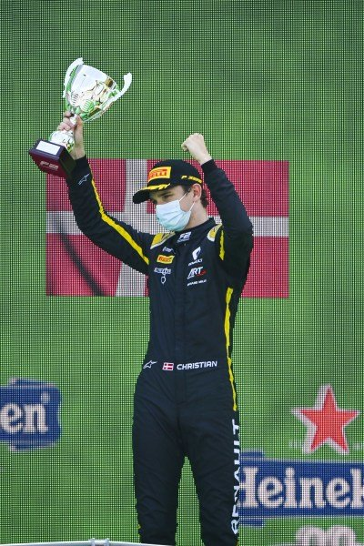 Christian Lundgaard (DNK, ART GRAND PRIX) celebrates on the podium with the champagne