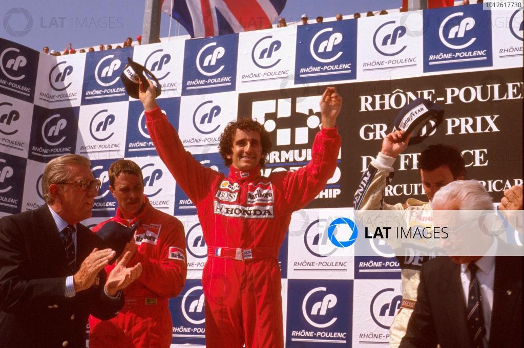 Paul Ricard, Le Castellet, France.7-9 July 1989.Alain Prost (McLaren Honda) 1st position, Nigel Mansell (Ferrari) 2nd position and Riccardo Patrese (Williams Renault) 3rd position, celebrate on the podium. FIA President Jean Marie Balestre applauds.Ref-89 FRA 14.World Copyright - LAT Photographic