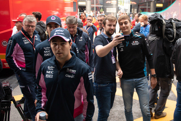 Sergio Perez, Racing Point and George Russell, Williams Racing takes a selfie with a fan