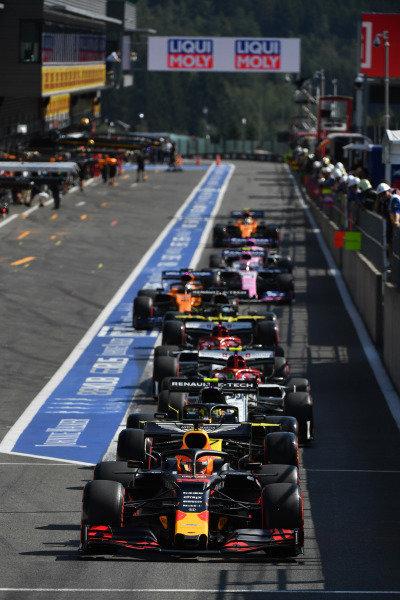 Max Verstappen, Red Bull Racing RB15, lines-up ahead of Nico Hulkenberg, Renault R.S. 19 in the pit lane