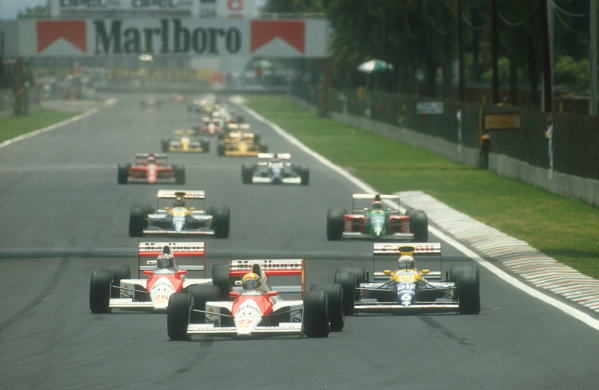 1990 Mexican Grand Prix.Mexico City, Mexico.8-10 June 1990.Ayrton Senna leads Gerhard Berger (both McLaren MP4/5B Honda's), Riccardo Patrese, Thierry Boutsen (both Williams FW13B Renault's) and Nelson Piquet (Benetton B190 Ford) at the start.Ref-90 MEX 02.World Copyright - LAT Photographic