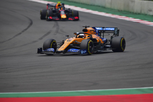 Carlos Sainz Jr., McLaren MCL34, leads Alexander Albon, Red Bull RB15
