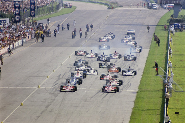 Pole sitter Niki Lauda and team mate Clay Regazzoni in their Ferrari 312Ts lead the field off the start line.